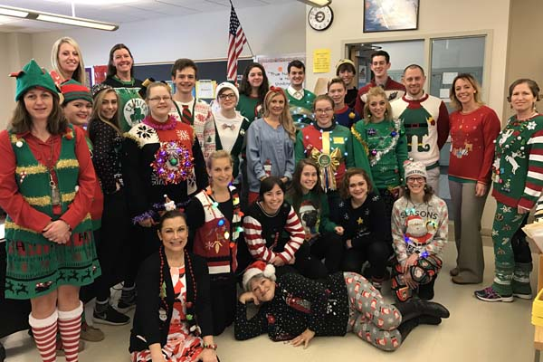 high school students in ugly Christmas sweaters
