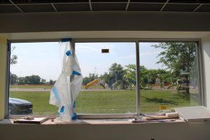 Middle school new principal's office window facing playground