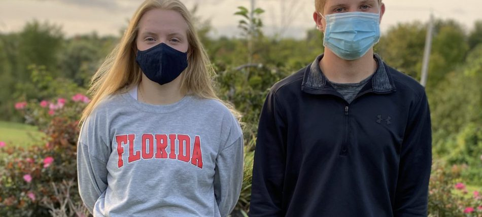two students in a mask